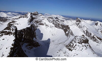 Winter in mountains - Mountain landscape from air Helicopter...