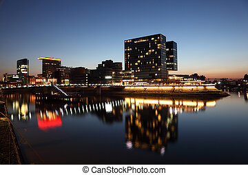 Night view of the Dusseldorf Media Harbor Medienhafen in...