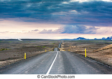 Ondulated and empty road in the sub-artic icelandic landscape