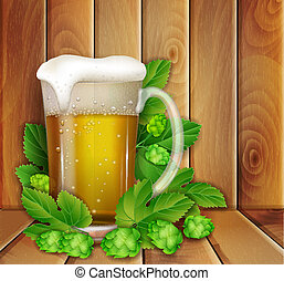 beer and hop on a wooden background