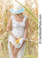 Woman in corn field