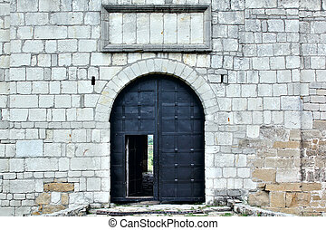 Big iron gates in the castle - Big iron gates with opened...