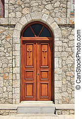 Church doors closed - Stone church facade wooden double...