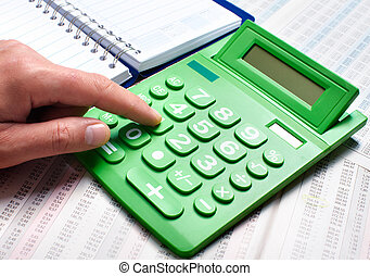 Hand of a businessman with calculator. - Hand with...