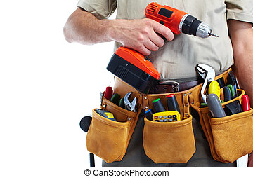 Handyman with a tool belt and drill. - Handyman with a tool...