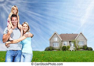 Happy family near new home.