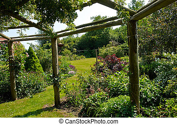 Pergola gazebo in a beautiful garden