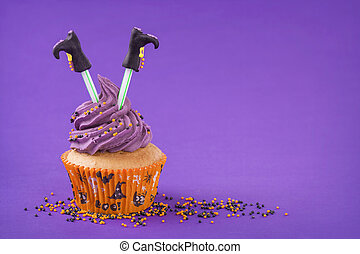 Halloween cupcake with witch legs