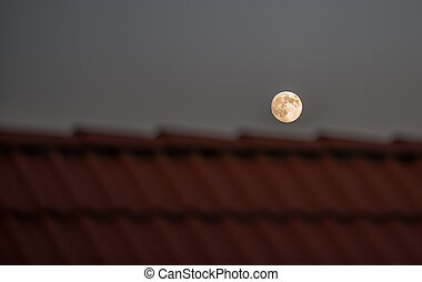 Fullmoon over roof