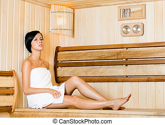 Half-naked woman relaxing in sauna Concept of self-care,...
