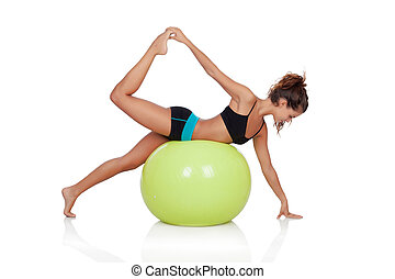Woman doing pilates with a ball isolated on white background