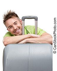 Tourist leaning on travel suitcase - Male tourist leaning on...