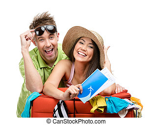 Couple packs up suitcase with clothing for trip - Couple...