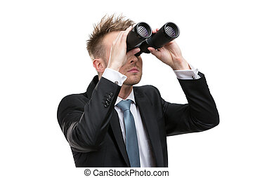 Businessman with binoculars - Business man wearing suit with...