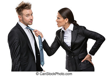Two business people debate and fight, isolated on white....