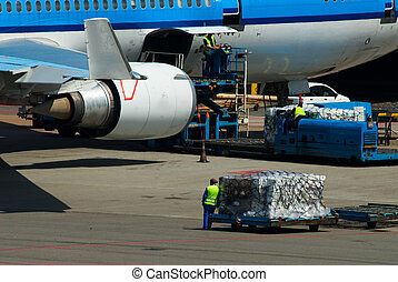 loading cargo - aircraft loading cargo on airport