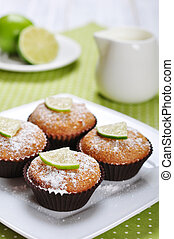 Diet muffins with bran  and fresh lime on plate