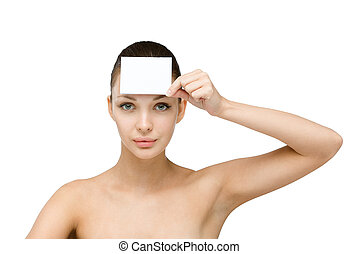 Nude girl hands copyspace card in front of her forehead -...