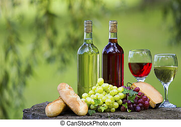 Wine Bottles - Two bottles of wine and glasses, some grapes,...
