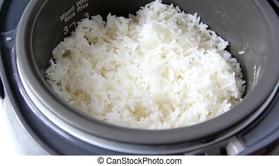 rice in electric rice cooker - closeup to rice in electric...