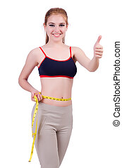 Young girl with centimeter in dieting concept