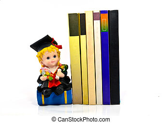 graduation resin doll and books on white background