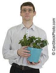 Man in spectacles with window plant