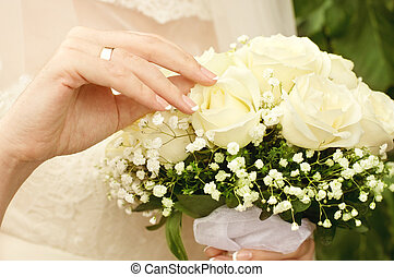 wedding bouquet at brides hands