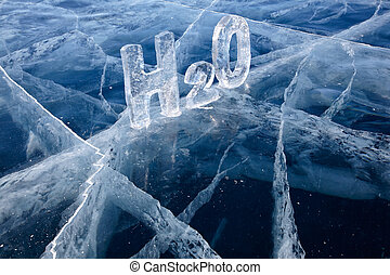 Chemical formula of water H2O made from ice on winter frozen...