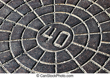 Manhole Cover with the number 40