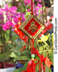 "Chinese character ""Spring\"" in gold"
