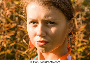pouting lips - girl sunlit with pouty lips and orange...