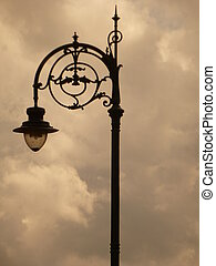 Old Street Light - Decorative old street light silhouetted...