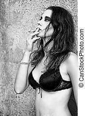Sexy beautiful young girl smoking cigarette. Closeup...