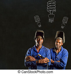 African black men industrial workers with engery saver on blackboard background