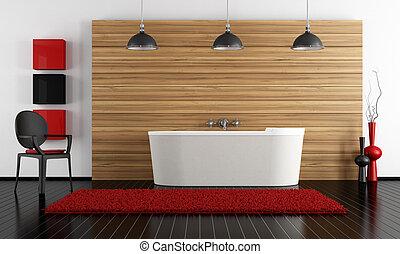 minimalist bathroom with stone bathtub against a wooden...