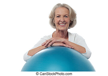 Senior woman posing with exercise ball - Smiling fit aged...