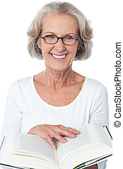 Smiling senior woman reading a book - Image of aged woman...