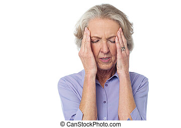Old lady suffering from headache - Aged woman holding head...