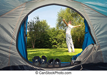 Man stretching on camping