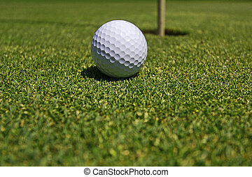 Golf - Ball with Hole - Hole focussed - golf meadow with a...