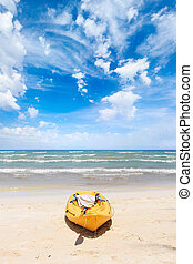 Tropical beach landscape with canoe boat at ocean gulf under...