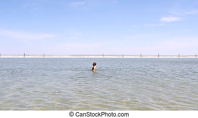 Salt Lake Baskunchak, Russia May 11, 2013 Man swimming