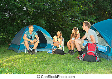 Friends on camping - A group of friends sitting in front of...