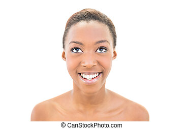 Portrait of smiling natural beauty looking up - Portrait of...
