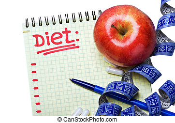 notepad with diet plan and a measuring tape with pills