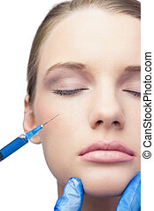 Content pretty model having botox injection on the cheek -...