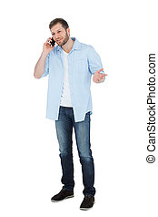 Relaxed male model posing while making a call
