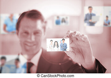 Smiling businessman picking a picture
