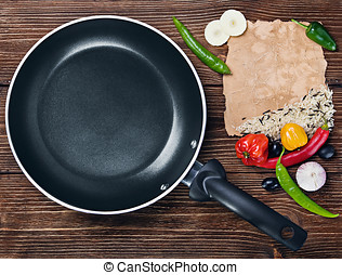 rice with vegetables next to a frying pan and paper for...